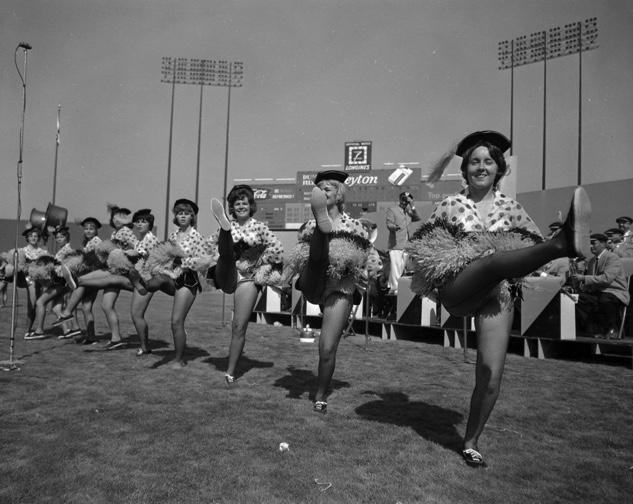 cheerleaders in 1960's kicking like rockets