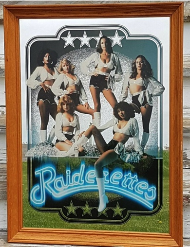6 Los Angeles Raiderettes in uniforms posed in poster